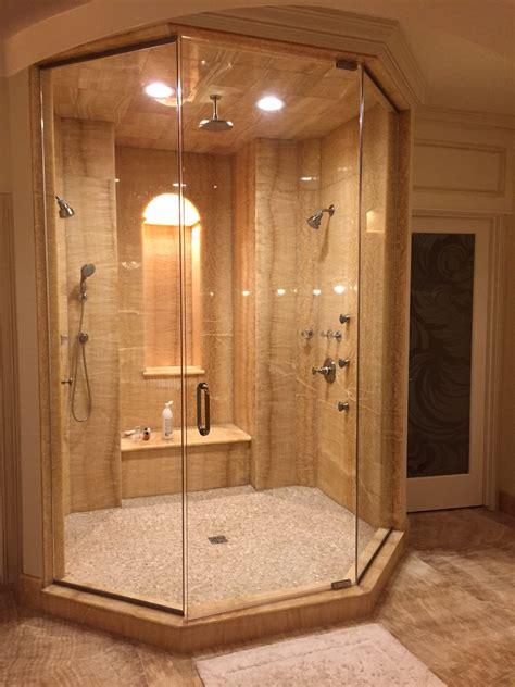 honey onyx shower stone city kitchen bath design