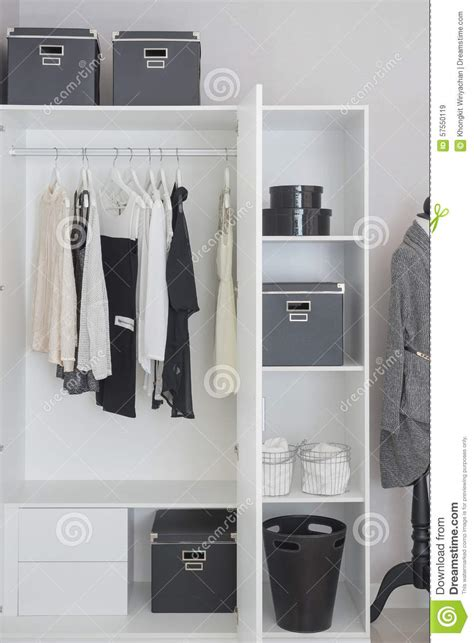 White Hanging Wardrobe by Black And White Clothes Hanging In Wardrobe Stock Image