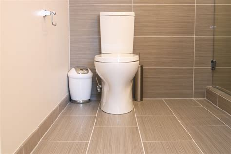 Tiling A Bathroom Floor by Shower With Gray Tile Bench And Beachstone Floor Modern