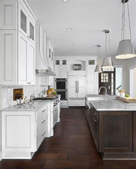large white kitchen boasts  exquisite dark brown island
