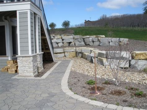 landscaping with limestone blocks landscaping before and
