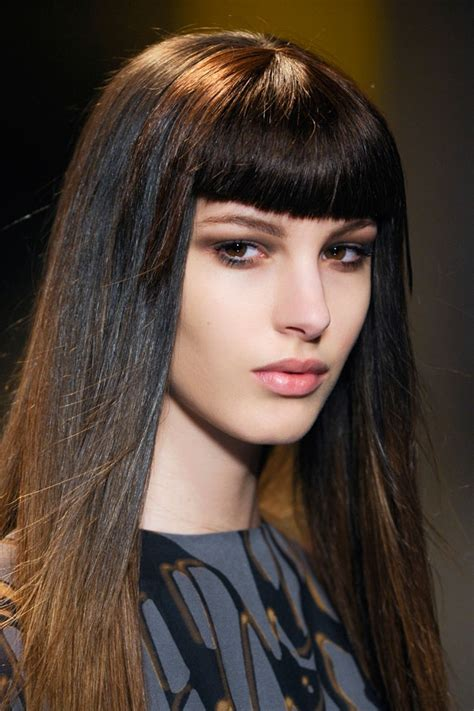 long straight dark hairstyle with blunt bangs