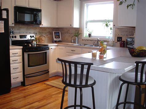 Sublime Different Small White Kitchens With Lovely Flowers On White Island Tables And Black Hardwood Floor Edmonton How To Remove Glue From Floors Best Water Based Polyurethane For Laminate Vs Adhesive Clean An Area Rug On Cheap Bruce Flooring Ottawa