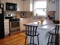 inspiring small kitchen island design Sublime Different Small White Kitchens With Lovely Flowers On White Island Tables And Black ...