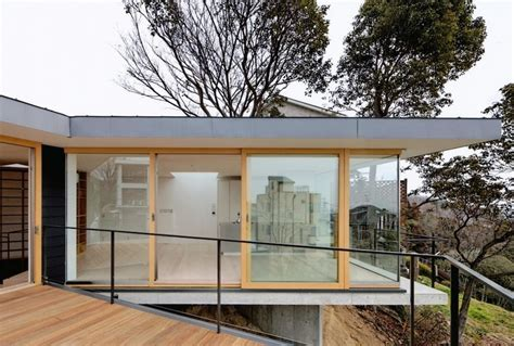 Steep Slope House With Bookshelflined Interior