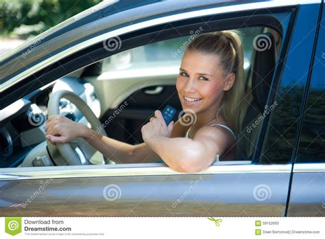 Young Girl In Car With Car Key Stock Photo