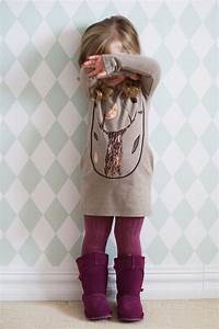 Picture Of purple tall suede boots and tights of the same shade a neutral dress with a tree printed