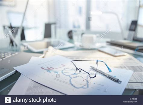 Paper On Desk by View Of Desk With Glasses And Pen On Top Of Papers