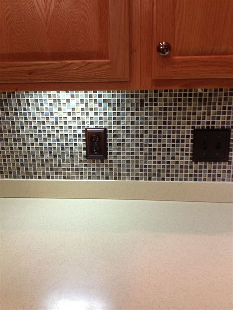 corian tile mosaic tile backsplash oak cabinets corian countertops