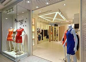 Interiors for small clothes shops boutique store designs for Interior decorating online store