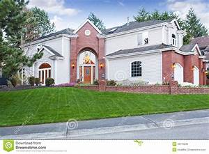 House Exterior. View Of Wall With Flower Bed Royalty