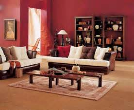 simple living room design with brown white sofa wooden coffee table red wall paint and wooden