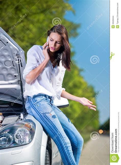 beautiful woman  car trouble talking  phone stock