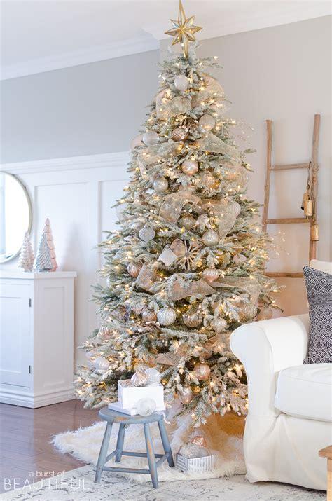 a snowy flocked christmas tree christmas tree decorating