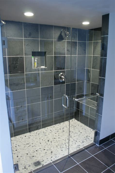 corner floor mat white acrylic surround jacuzzy beside glass wall shower