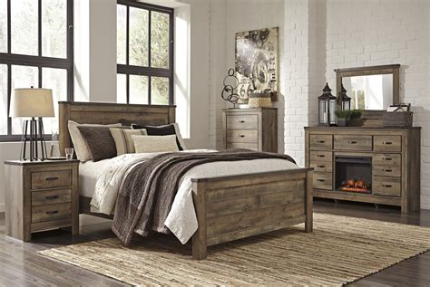 trinell panel bed bernie phyls furniture  ashley