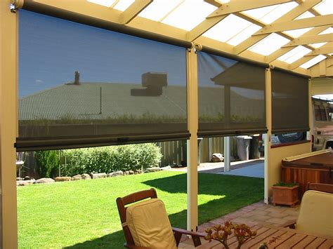 country house with wrap around porch screen porch roll up blinds
