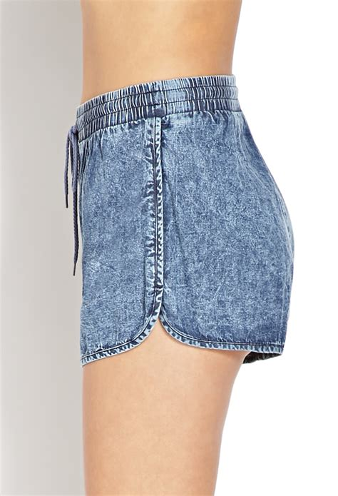 lyst   acid wash dolphin shorts  blue