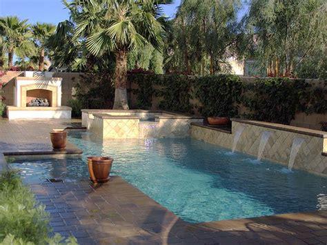 spanish tile pool  fireplace  spa backyard