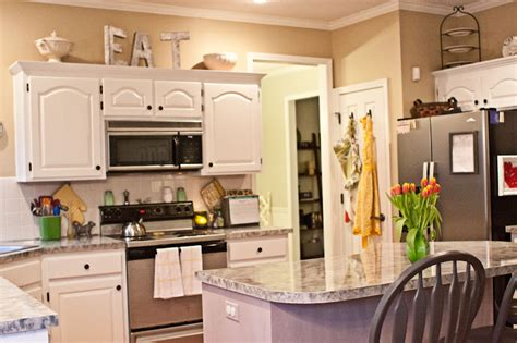 decorating ideas for top of kitchen cabinets decorating above kitchen cabinets with flowers