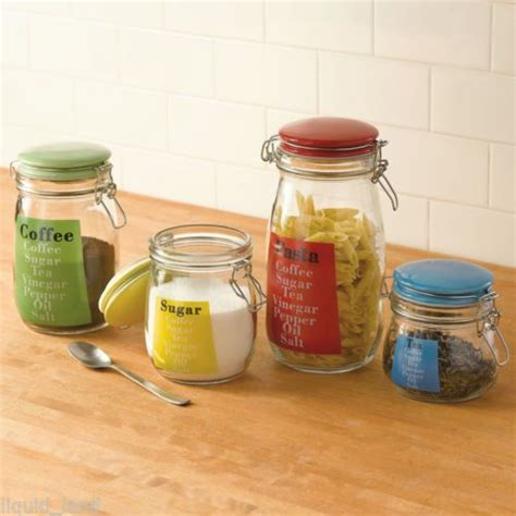 colored kitchen canisters set of 4 glass kitchen canisters w multi colored lids