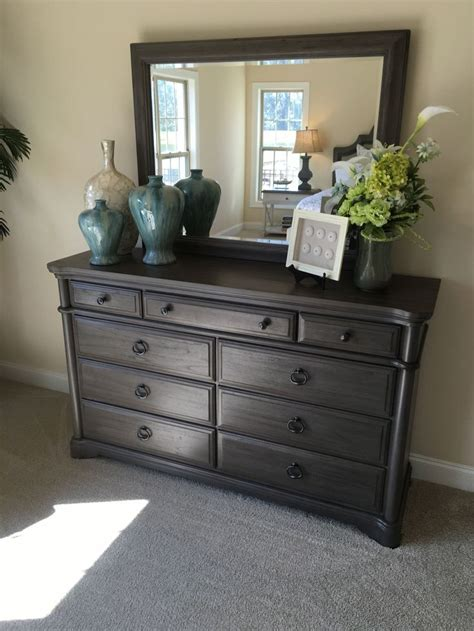 Decorating Ideas Dresser how to stage a bedroom dresser with vases urns frames