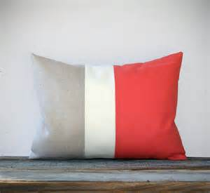 coral color block decorative pillow with cream and natural