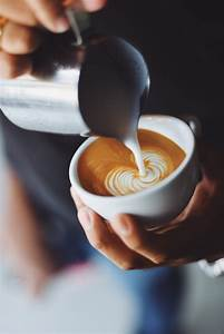 Person Serving A Cup Of Coffee Photo