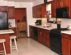 kitchen cabinet moulding black appliances wood floor green kitchen traditional 2634