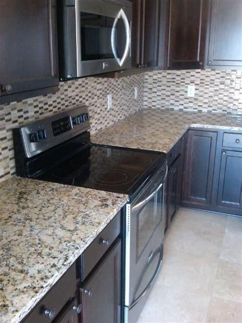 backsplash for espresso cabinets espresso cabinets and venetian gold granite counter tops