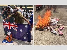 Australian Flag burnt during an Indigenous rally on the