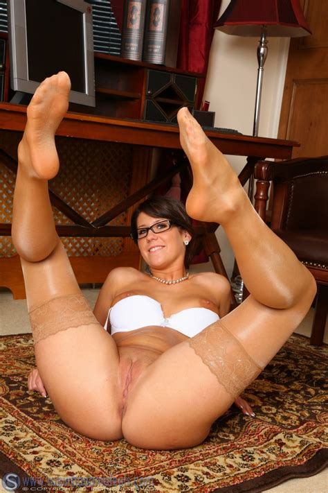 Secretary Lilly In Glasses Strips To Her Tan Holdups For Some Office Fun Photo Gallery
