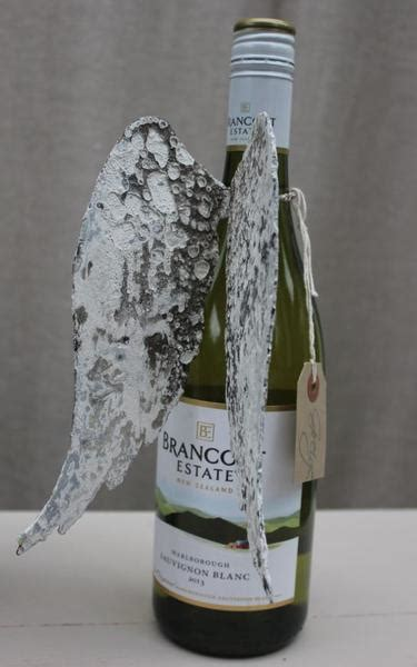aged metal angel wings bottle decoration