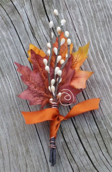 fall wedding boutonniere leaves maple flowers twigs deer