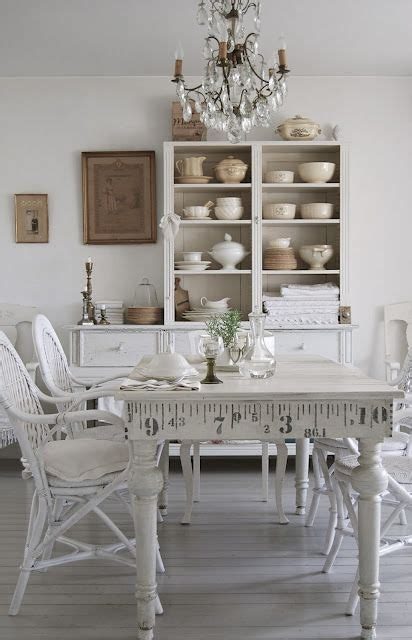 shabby chic dining room cabinets a beautiful white dining room room table that matches the cabinets and walls perfectly