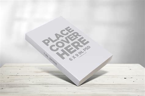 Synonyms for coffee include java, joe, brew, café, café au lait, café noir, caffeine, cappuccino, decaf and decoction. 6x9 Book on Coffee Table Template Mockup - Covervault