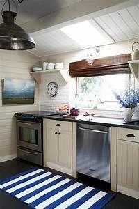 tan beadboard kitchen cabinets cottage kitchen With kitchen colors with white cabinets with nautical wall art decor