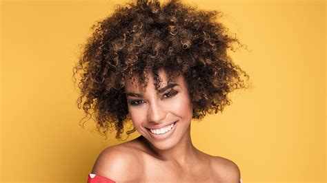 How To Style Short Curly Hair While Growing It Out