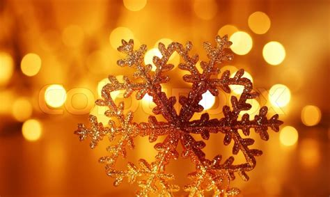 snowflake background golden christmas tree ornament and