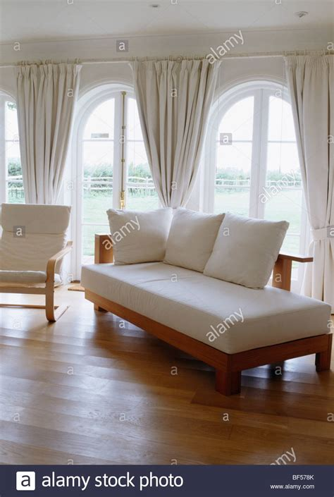 day bed  white cushions  living room  wooden