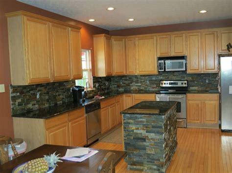 backsplashes  black granite countertops  black granite countertops  maple cabinets