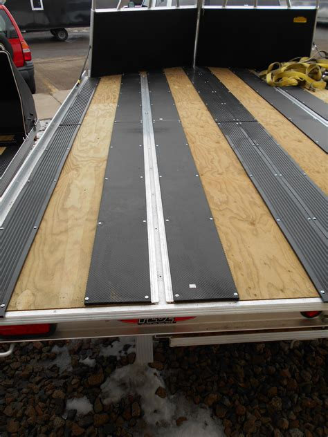It is horse mat and the only negative thing about it so far is that direct contact with gasoline causes it to swell. Ski Guides and Mats for Snowmobile Trailers | M&G Trailer ...