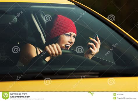 Angry Woman Shouting On The Phone In A Car Stock Photo
