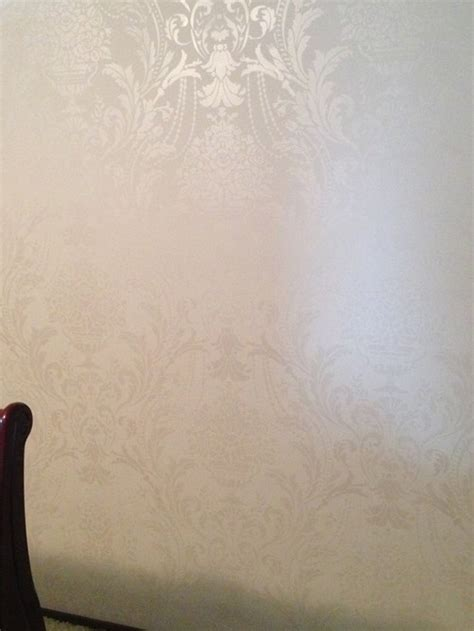 damask stencil shimmers in modern masters snow white