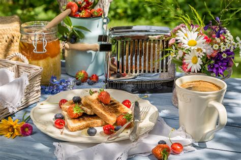Buy direct & get it fresh! Coffee, Toast And Fruit For Breakfast In The Garden Stock Image - Image of morning, dieting ...