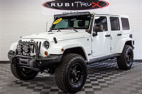 jeep wrangler white pre owned 2012 jeep wrangler sahara unlimited white