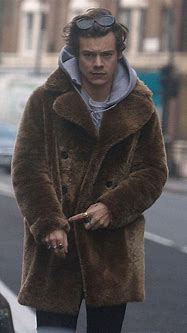Harry Styles in the Shaggy Statement Fur Coat   Vogue