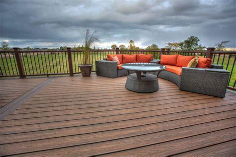 custom trex deck and sted concrete patio near saline mi
