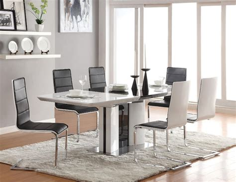 black leather chairs with solid wooden white dining table