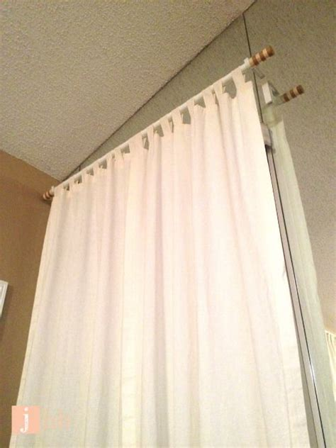 on how to hang curtains without drilling